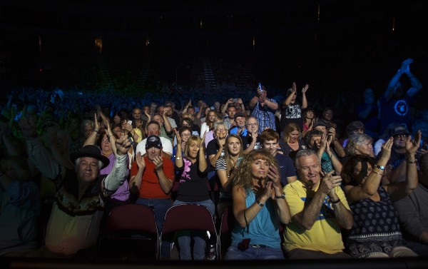 Audience members cheer on John Fogerty during his show Saturday at Cross Insurance Center in Bangor.