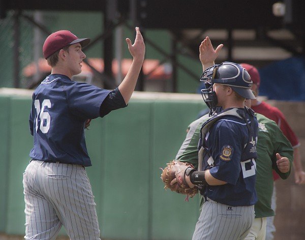 Comrades pitcher Justin Courtney gets a congratulation from catcher Hunter Boyce (20) after ending the home half of the seventh inning of their American Legion Championship game against Bessey Motors at Husson University in Bangor, Maine, Sunday, Aug. 3, 2014.