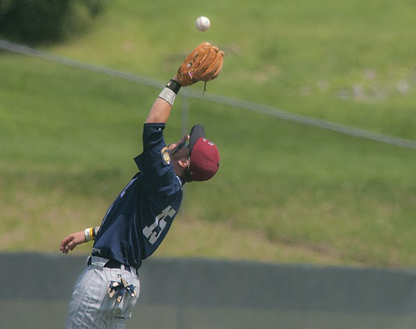 Comrades second baseman Sam Huston leans back to make a catch on a fly ball in the fifth inning of their American Legion Championship game against Bessey Motors at Husson University in Bangor, Maine, Sunday, Aug. 3, 2014.