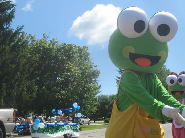Sweet Frog and Mrs. Sweet Frog from the Sweet Frog frozen yogurt business in Bangor greeted parade watchers along Route 2.