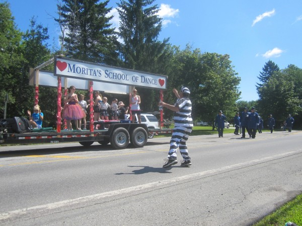 A prisoner from the KeyStone Kops danced with the Morita's School of Dance float participants during the Hermon Fun Day parade on Aug. 9.