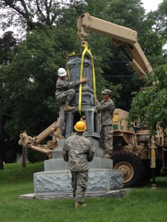 The 1136th Transportation Unit of the Maine National Guard  helped Orono Historical Society move monument base.