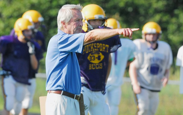 Bucksport High School Football coach Joel Sankey works with the team prior to a scrimage against Houlton High School on Aug. 25 at Carmichael Field in Bucksport.