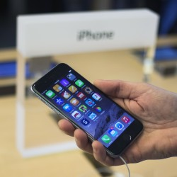 Apple unveils 2 new iPhones, including a cheaper model to combat rivals