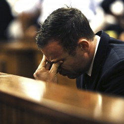 Pistorius breaks down, retches as girlfriend's wounds are described during murder trial