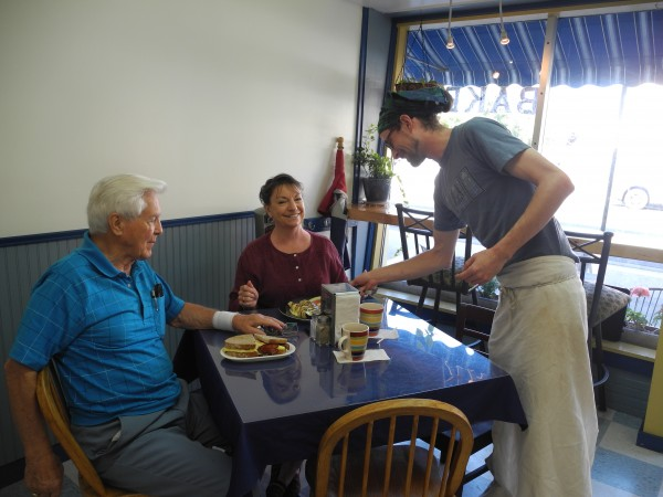 Patrick Kelley, baker and co-owner of the new Coastal Cafe & Bakery in Searsport, serves breakfast this week to Bob and Simone Ahrens of Victoria, Texas.