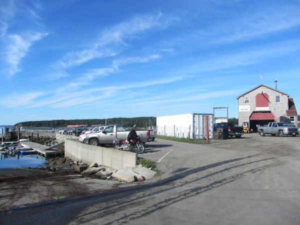 St. George is looking into the purchase of waterfront property adjacent to the town pier. The town pier is to the left and the property being sought is on the right with the two-story building.