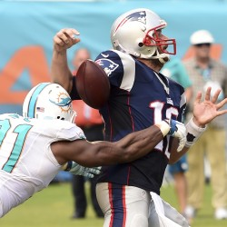 Rookie Thomas saves Dolphins' win over Patriots