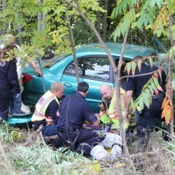 Woman falls asleep, crashes car in woods off Route 3