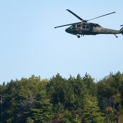 Army National Guard unit helicopters bring firefighting equipment to remote Maine Island