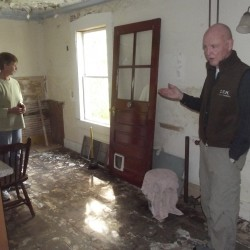 Nancy Ives (left) and Peter Duston explain how the former kitchen of the Lamb House will be renovated into a bathroom and utility room. The house needs an estimated $20,000 worth of renovations and repairs.