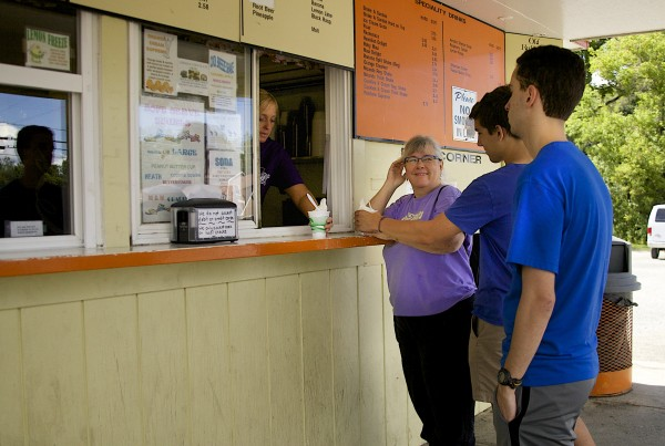 Tricia Welsch, a Bowdoin professor, waits for her ice cream at Houlton Farms Dairy. Welsch recently brought a group of new students to the diary bar after a day of volunteering.