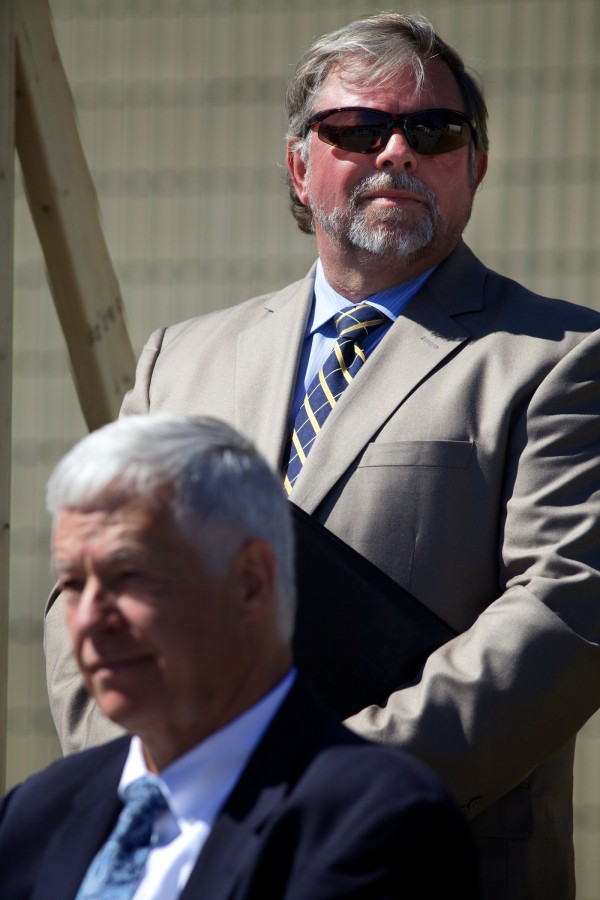 Steve Levesque, executive director of the Midcoast Regional Redevelopment Authority, stands behind U.S. Rep. Mike Michaud on Thursday as officials celebrated the unveiling of TechPlace, a manufacturing incubator on the former Navy base in Brunswick.