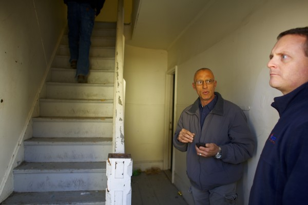 Executive Director Michael Myatt (right) and Director of Maintenance Bob Rhodes Jr. of Bangor Housing walk into a home on First Street in Bangor in this October 2013 file photo.