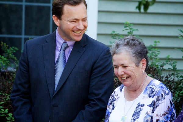 Lee Picker (right) smiles after speaking at a news conference in Brunswick, where Maine House Speaker Mark Eves announced a series of proposals designed to build more affordable housing for seniors and otherwise help them remain in their homes as they age in this August 2014 file photo.
