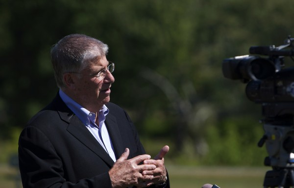 Eliot Cutler speaks with members of the media following a press conference at the park on Maine Street in Old Town Thursday. Cutler spoke about jobs and the economy in Maine.
