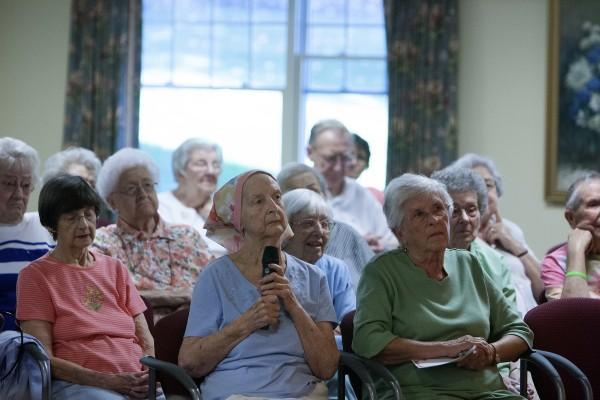 Senior citizens listen as Gov. Paul LePage speaks on Wednesday at Ellen Leach Home in Brewer.