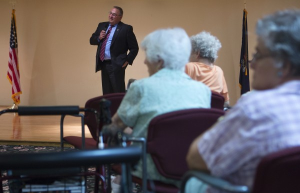 Gov. Paul LePage talks on Wednesday with residents at the Ellen Leach Home in Brewer.