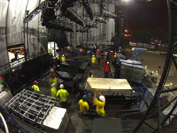 Crews tear down the stage for the Jason Aldean Concert on Sunday at the Darling's Waterfront Pavilion in Bangor.