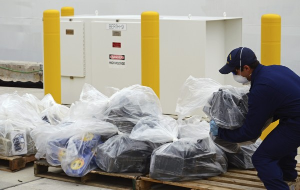 Coast Guard personnel offloads part of a 2,800-kilogram cocaine seizure at the Coast guard base in Miami Beach, Florida Sept. 4, 2014. Nearly three dozen United States Coast Guard personnel spent more than an hour unloading almost $93 million of cocaine after it was seized in the Caribbean near Panama in late August.