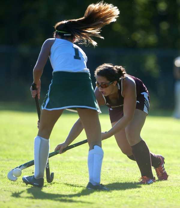 Foxcroft Academy's Avery Carroll (right) moves the ball around Old Town's Jordyn Fostun during their field hockey game on Wednesday at Old Town.
