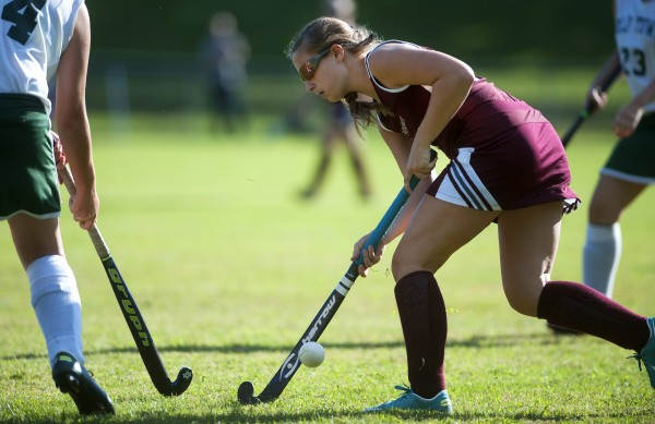 Foxcroft Academy's Emily Curtis moves the ball up the field during the field hockey game on Wednesday at Old Town.