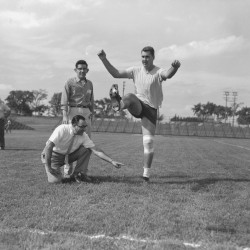 New York Giants great Pat Summerall kicks the ball as Anthony Rogera of P. Ballantine Inc. holds in the pregame workout on Sept. 4, 1959, in Bangor. Ed McInnis of the Bangor Jaycees witnesses Summerall's boot into the uprights.