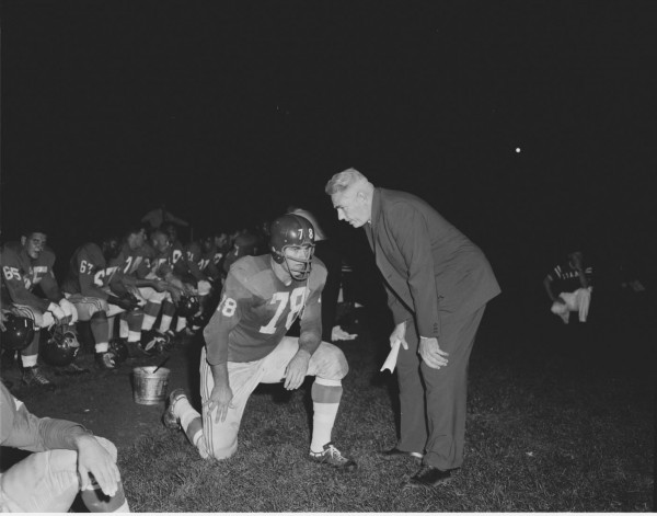 Giants coach Jim Lee Howell talks to tackle Bob Schmidt on the sidelines moments after coming off the field of play during a Giants-Packers game in Bangor in 1959.