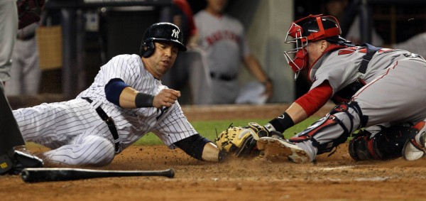 Carlos Beltran of the New York Yankees is tagged out at the plate by Boston Red Sox catcher Christian Vazquez during the seventh inning of Wednesday night's game at Yankee Stadium in New York. The Yanks won 5-1.
