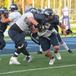 Windham's Charles sees forest through the trees from spot on UMaine defensive line