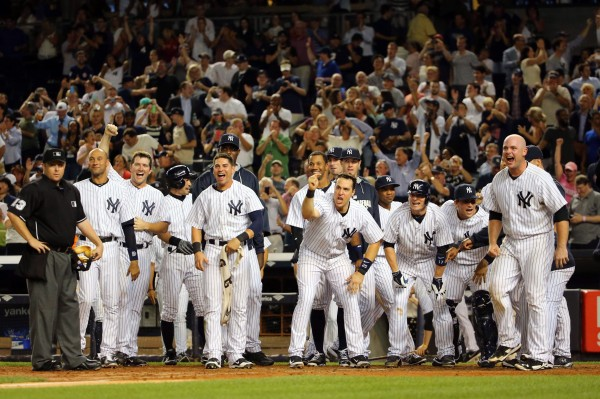 Members of the New York Yankees react to Chase Headley's walk-off home run during the ninth inning against the Boston Red Sox Thursday night at Yankee Stadium. The Yankees won 5-4.