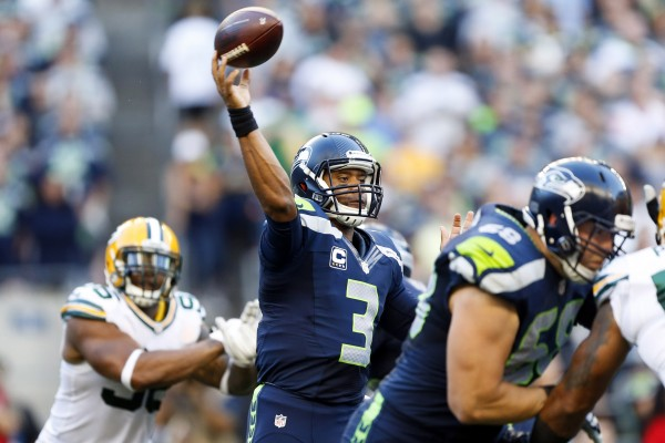Seattle Seahawks quarterback Russell Wilson (3) passes against the Green Bay Packers during the second quarter at CenturyLink Field in Seattle Thursday night.