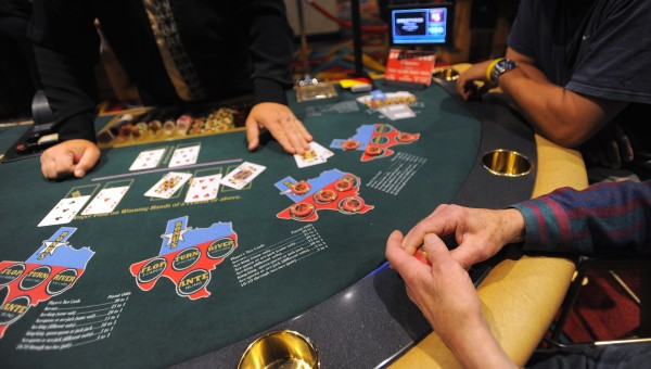 People play Texas Hold'em at the Hollywood Casino in Bangor last year.
