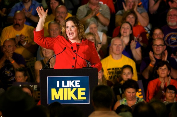 Maine congressional candidate Emily Cain jokes about the heat at the Portland Expo while stumping for herself and gubernatorial candidate Mike Michaud on Tuesday in Portland.