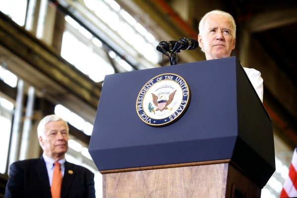 Vice President Joe Biden speaks to a crowd at Portsmouth Naval Shipyard in Kittery on Wednesday while U.S. Rep. Mike Michaud listens.