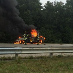 Two tractor trailers collide, one bursts into flames in Kennebunk