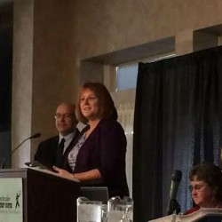 Bangor City Clerk Lisa Goodwin accepts her award after she was named recipient of the 2014 Lorraine M. Fleury Award at the State Elections Administration Conference on Sept. 25  in Bangor.
