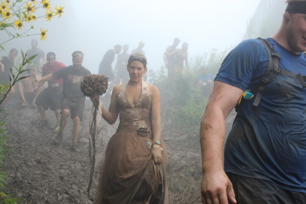 Looking a little worse for wear, Jennifer Fisher's white wedding dress was anything but white as she negotiated her way through the Wintergreen Mountain Spartan Race on her way to the wedding alter with Steve Fisher on Aug. 23.