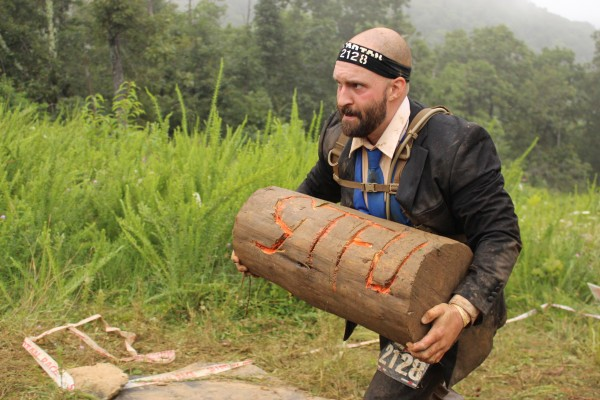 Steve Fisher had to work his way through about a dozen obstacles and carry a log before meeting up with his bride Jennifer Fisher at the finish line of the Wintergreen Mountain Spartan Race.