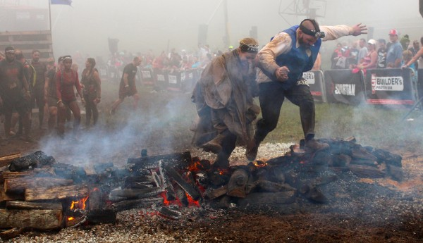 Jumping over the fire pit was the final obstacle at the Wintergreen Mountain Spartan Race for Jennifer and Steve Fisher.