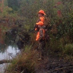Scott Cates of Old Town and his nephew, Grady Vanidestine, 9, of Brewer, went looking for moose Monday on the first day of the hunting season.