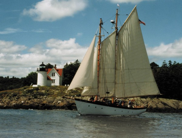 Schooner Olad sailing past Curtis Island Lighthouse.