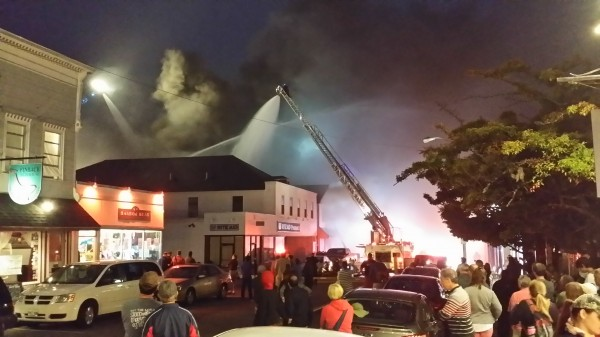Firefighters work to extinguish flames at the Portside Grill in Bar Harbor on Tuesday night.