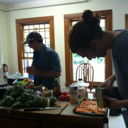 Students prepare a meal using food gleaned from the waste stream Sunday as part of the Peach House Café.