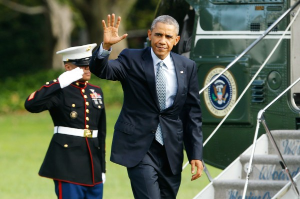 U.S. President Barack Obama waves as he arrives via Marine One helicopter at the White House in Washington October 14, 2014.