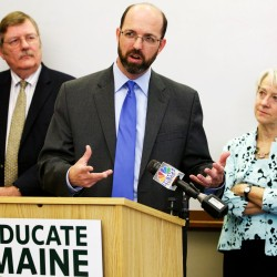 "Yellow Light Breen (center) of Bangor Savings Bank speaks at a press conference in Portland on Thursday. Breen is flanked by Chris Hall (left) of the Portland Regional Chamber of Commerce and Meredith Jones (right) of the Maine Community Foundation as Educate Maine released its ""Education Indicators for Maine"" report."