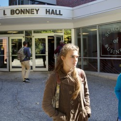 Katie Arnold (left) and Ali Sinclair, both juniors at the University of Southern Maine, stand outside Luther Bonney Hall on the Portland campus Monday where they agreed the latest round of faculty cuts are unfortunate, but probably necessary for USM in the long run.