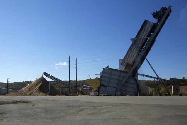 A truck filled with chip is unloaded on Thursday at the Verso Paper mill in Bucksport.