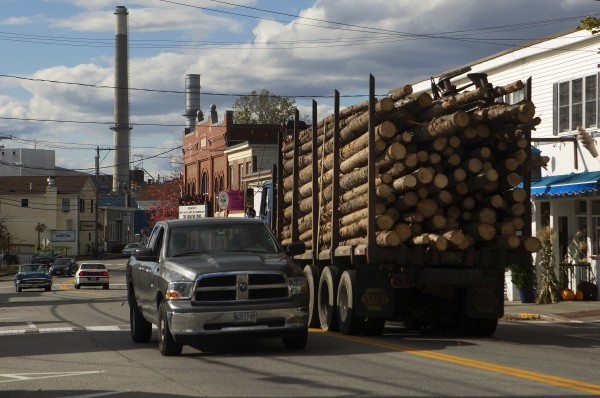 A truck filled with logs heads towards the Verso Paper mill Thursday in Bucksport.
