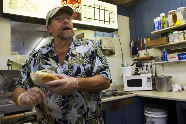 Tozier's employee Terry Bowden wraps a freshly made sandwich on Wednesday at the store in Bucksport. After the announcement of the Verso Paper mill closing, the future of many local business is uncertain.